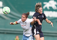 Sonia Bompastor #8 of the Washington Freedom goes for a header with Carli Lloyd #10 of the Chicago Red Stars during a WPS match at RFK stadium on June 13 2009 in Washington D.C. The game ended in a 0-0 tie.