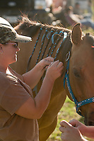 Johnsville, MD: J Bar W Ranch -- Julie Talbert, of Thurmont, braids Lauren Rhen's horse Bo's mane.