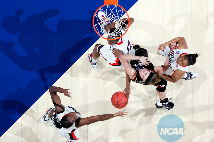 05 APR 2009:  Tina Charles (31) of the University of Connecticut pulls down a rebound over Kayla Pedersen (14) of Stanford University during the Division I Women's Basketball Semifinals held at the Scottrade Center  in St. Louis, MO.  Connecticut defeated Stanford 83-64 to advance to the national title game.  Jamie Schwaberow/NCAA Photos