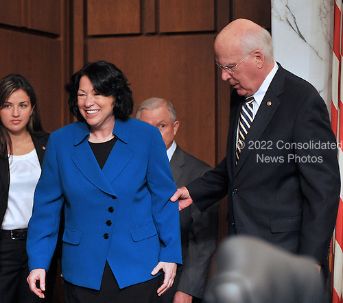 Washington, DC - July 13, 2009 -- United States Senator Patrick Leahy (Democrat of Vermont), right, Chairman of the U.S. Senate Judiciary Committee, escorts Judge Sonia Sotomayor, left, to the witness table as the committee considers her nomination as Associate Justice of the U.S. Supreme Court on Monday, July 13, 2009..Credit: Ron Sachs / CNP