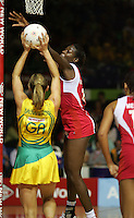 16.11.2007 Australian Sharelle McMahon and England's Sonia Mkoloma in action during the Australia v England match at the New World Netball World Champs held at Trusts Stadium Auckland New Zealand. Mandatory Photo Credit ©Michael Bradley.