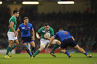Peter O'Mahony of Ireland faces up to the tackle of Rabah Slimani of France during Match 39 of the Rugby World Cup 2015 between France and Ireland - 11/10/2015 - Millennium Stadium, Cardiff<br /> Mandatory Credit: Rob Munro/Stewart Communications