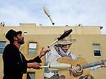Americana.<br /> <br /> Mural and juggler, Denver, Colorado.