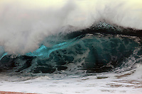 A giant breaking wave on the North Shore of O'ahu.
