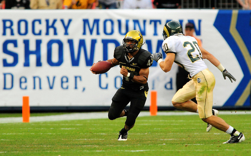 31 Aug 2008: Colorado tailback Rodney Stewart (43) carries the ball against Colorado State defensive back Klint Kubiak (20). The Colorado Buffaloes defeated the Colorado State Rams 38-17 at Invesco Field at Mile High in Denver, Colorado. FOR EDITORIAL USE ONLY