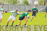 Churchill's Fiachra Griffin get away from Na Gaeil's Eamon O'Neill in the division 4 game in Tralee on Sunday.