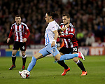 Billy Sharp of Sheffield United in action with Jodi Jones of Coventry City during the English League One match at the Bramall Lane Stadium, Sheffield. Picture date: April 5th, 2017. Pic credit should read: Jamie Tyerman/Sportimage