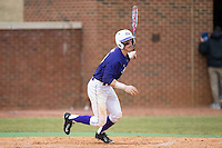 Chris Clare (9) of the High Point Panthers follows through on his swing against the UNCG Spartans at Willard Stadium on February 14, 2015 in High Point, North Carolina.  The Panthers defeated the Spartans 12-2.  (Brian Westerholt/Four Seam Images)