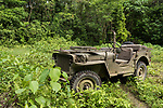 Munda, Western Province, Solomon Islands; a 1942 Jeep Willy is parked on one of the original jungle roads used by US troops during World War II, it is the only known restored and functioning Jeep from that era in the Solomon Islands