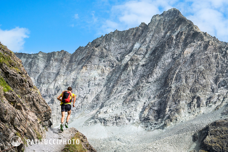 The Chamonix to Zermatt Glacier Haute Route. In late August 2017, we ran the tour in mountain running gear, running shoes, and all the necessary glacier travel and crevasse rescue gear. Running to the Chanrion Hut on a steep section of trail.