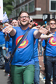 "29 June 2013, London, United Kingdom. Picture: members of the London Gay Men's Chorus sing and dance in the street. Pride London 2013 parade starts with the motto ""love (and marriage)""."