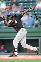 Outfielder Roderick Bernadina (11) of the Delmarva Shorebirds bats in a game against the Greenville Drive on Monday, April 29, 2013, at Fluor Field at the West End in Greenville, South Carolina. Greenville won, 3-1. (Tom Priddy/Four Seam Images).