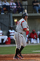 Yonder Alonzo of the Carolina Mudcats hittingin an exhibition game versus the Cincinnati Reds on April 3, 2009