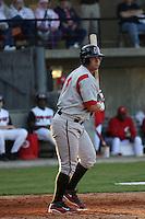 Yonder Alonzo of the Carolina Mudcats hittingin an exhibition game versus the Cincinnati Reds on April 3, 2009