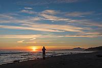 Photographer along the Gulf of Alaska beach and Mt. Fairweather, Glacier Bay, Alaska.