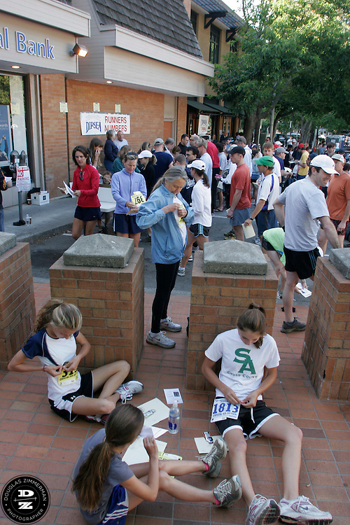 Dipsea runners relax and get ready in downtown Mill Valley before the 98th running of the Dipsea Race from Mill Valley, Calif. to Stinson Beach over Mt. Tamalapais.  The race  happened on Sunday, June 8, 2008.