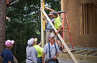 NWA Democrat-Gazette/CHARLIE KAIJO Volunteers help build the porch of a home, Friday, June 8, 2018 on Passion Play Road, across the street from the Washington Regional clinic in Eureka Springs. <br /><br />Eight tiny houses are being built in Eureka Springs, which has a dearth of affordable housing. They're being constructed by 66 volunteers from 13 states with World Mission Builders. They began work on Monday (June 4) and should finish most of the construction by the end of next week (June 15). Then local volunteers will finish out the interiors and put shingles on the roofs. The first eight houses are part of what will be called ECHO Village. Plans are to eventually have 26 houses in the village. It's a project of Eureka Christian Health Outreach, which bought 10 acres for the village. The same group started ECHO Clinic in Eureka Springs in 2005. It provides free medical care to the uninsured and people on a low income.