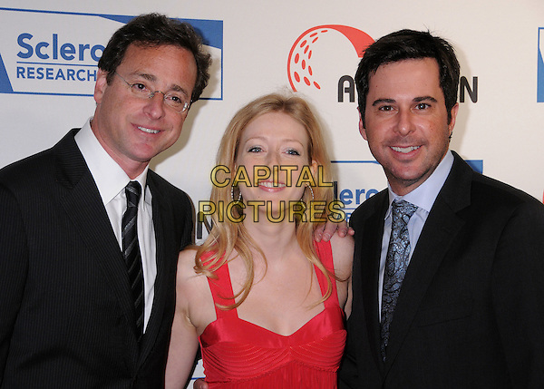 "BOB SAGET, JENNIFER FINNIGAN & JONATHAN SILVERMAN.Scleroderma Research Foundation?s ""Cool Comedy - Hot Cuisine"" 2008 at the Four Seasons Beverly Wilshire Hotel, Beverly Hills, California, USA..April 16th, 2008.half length black jacket suit red dress .CAP/ADM/BP.©Byron Purvis/AdMedia/Capital Pictures."