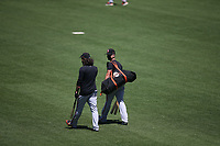 SAN FRANCISCO, CA - JULY 6:  Buster Posey #28 and Brandon Crawford #35 of the San Francisco Giants walk on the field while wearing a mask during summer training camp at Oracle Park on Monday, July 6, 2020 in San Francisco, California. Due to COVID-19, the 2020 MLB season has been postponed with players just beginning to return for warmups and practices while wearing masks and keeping social distance. (Photo by Brad Mangin)