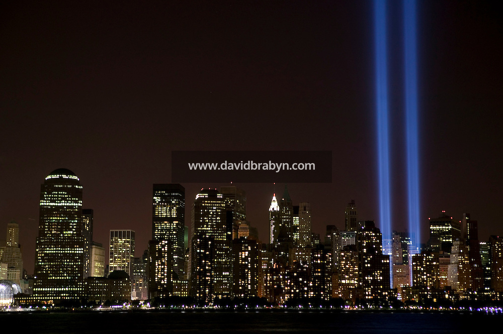 11 September 2005 - New York City, NY - A one-night installation shines beams of light up into the sky above Downtown Mahattan in New York City, USA, on 11 September 2005, the fourth annniversary of 9/11, as a tribute to victims of the terrorist attacks. Photo Credit: David Brabyn.