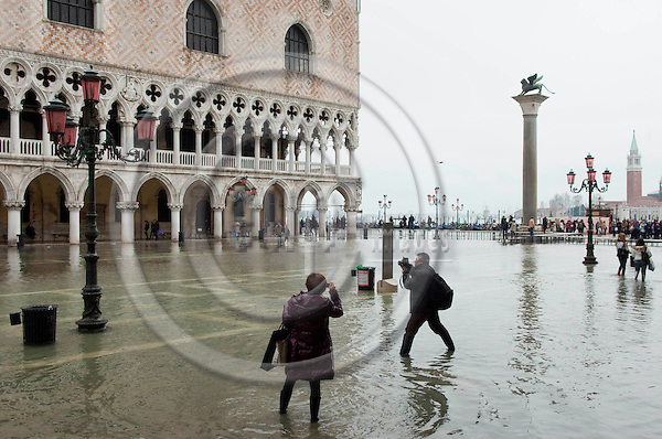 San Marco-Venice-Italy - December 24, 2010 -- Acqua alta, hIgh tides, tourists on flooded Piazetta of St. Mark's Square  -- tourism, infrastructure -- Photo: Horst Wagner / eup-images