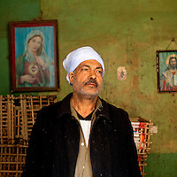 EGYPT / Cairo / March 2012 / A Coptic vegetable seller poses for a portrait in his shop in a quarter of Manhiyat Naser known as Garbage City, at the foot of the Moqattam Mountains in Cairo. Most of the popultation there is Coptic. <br />