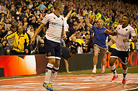 Steve Morison of Millwall celebrates his goal as a fan invades the pitch during the Sky Bet Championship match between Nottingham Forest and Millwall at the City Ground, Nottingham, England on 4 August 2017. Photo by James Williamson / PRiME Media Images.