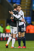 Bolton Wanderers' Tyler Walker hugs Fulham's Tim Ream at the end of the game<br /> <br /> Photographer Andrew Kearns/CameraSport<br /> <br /> The EFL Sky Bet Championship - Bolton Wanderers v Fulham - Saturday 10th February 2018 - Macron Stadium - Bolton<br /> <br /> World Copyright &copy; 2018 CameraSport. All rights reserved. 43 Linden Ave. Countesthorpe. Leicester. England. LE8 5PG - Tel: +44 (0) 116 277 4147 - admin@camerasport.com - www.camerasport.com