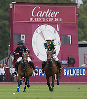 Marcos Di Paola (King Power) under pressure from Joaquin Pittaluga (Salkeld) during the Cartier Queens Cup Final match between King Power Foxes and Dubai Polo Team at the Guards Polo Club, Smith's Lawn, Windsor, England on 14 June 2015. Photo by Andy Rowland.