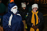 BETHLEHEM, CT. 07 December 2018-120718 - Debbie Aitola of Southbury, left, and her friend Alice Fay Nieves of Fort Myers, Florida stand out in the cold all bundled up waiting for Santa and the lighting of the big tree during the annual Christmastown Festival on the Town Green in Bethlehem on Friday. Bill Shettle Republican-American