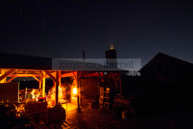 The constellation of Orion is visible in the night sky as fire shoots from the kiln's chimney Saturday night. The kiln was constantly monitored, stoked, and fed wood logs for 3 straight days.in Lexington, Ky., on Sunday, November, 18, 2012. Photo by James Holt | Staff
