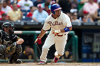 Philadelphia Phillies outfielder Shane Victorino #8 heads to first base during the Major League Baseball game against the Pittsburgh Pirates on June 28, 2012 at Citizens Bank Park in Philadelphia, Pennsylvania. The Pirates defeated the Phillies 5-4. (Andrew Woolley/Four Seam Images).