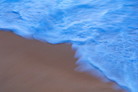 Close up beach, water, sand and foam