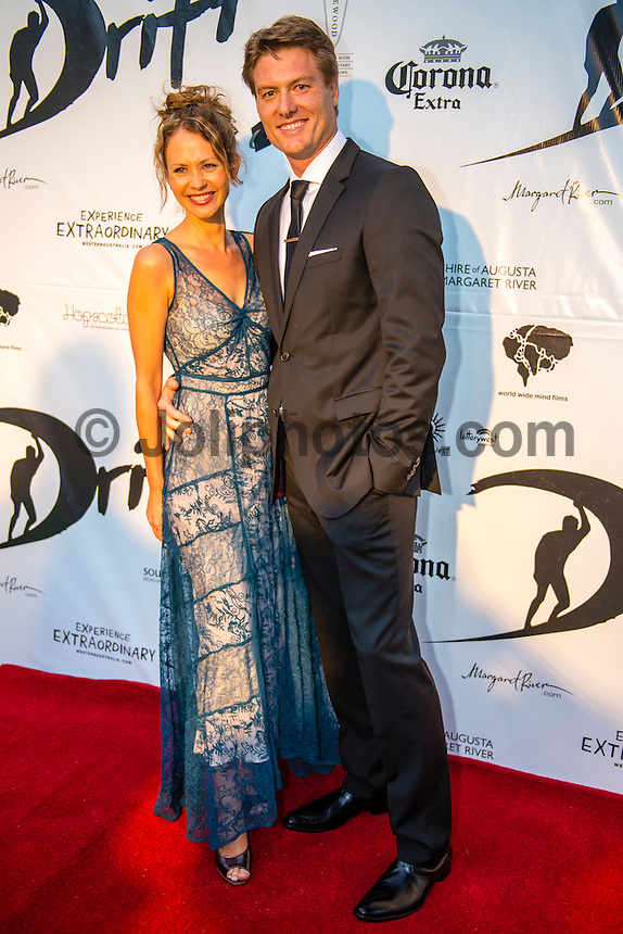 """Caves House Yallingup, Western Australia (Thursday, March 22, 2013) Leading actor and producer Myles Pollard (AUS) with wife Brigitta Wuthe (AUS). - .Over 60 metres of red carpet greeted the  1300 guests at the Australian premiere of the surfing movie, Drift, which was shot in Margaret River region and  screened under the stars at Caves House, Yallingup last night...The movie's major celebrity  Sam Worthington was absent from the opening but other big names including Xavier Samuel, fresh from his turn in the Twilight saga, and former McLeod's Daughters actor  Myles Pollard enjoyed the red carpet attention...The premiere will took the film back to its roots in WA's rugged and beautiful South-west region, with a large outdoor screening for over 1,300 people  held in the historic gardens at Caves House in Yallingup. .Drift - A story of passion, corruption, friendship and loyalty, deadly addictions and fractured relationships, tells a tale of courage and the will to survive at all odds...The Australian premiere of Drift was a proud moment for two of the film's West Australian producers, Tim Duffy and Myles Pollard...Myles, who also plays a leading character in the film, was excited to premiere the film to the local community...""""We are ecstatic that the Australian premiere of Drift is happening in the South-west. We have enormous respect for the local community that supported the movie and we're so happy to bring the spotlight back to the region for what promises to be a memorable and historical event,"""" he said...Walking the red carpet were the film's cast, co-directors Morgan O'Neill and Ben Nott, producers Tim Duffy, Myles Pollard and Michele Bennett, local WA crew, local dignitaries and investors, and over 300 extras from the region who feature in Drift...The timing of the premiere coincided with the 2013 Margaret River Pro surfing tournament with many of the world's best surfers attending such as Taj Burrow (AUS), Martin Potter (UK) and former WCT surfer Jake Paterso"""