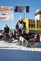Kristy Berington and team leave the ceremonial start line at 4th Avenue and D street in downtown Anchorage during the 2014 Iditarod race.<br /> Photo by Jim R. Kohl/IditarodPhotos.com