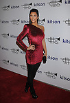 WEST HOLLYWOOD, CA. - October 21: Kimberly Kardashian arrives at the Lamar Odom launch of Rich Soil at Kitson L.A. on October 21, 2009 in West Hollywood, California.