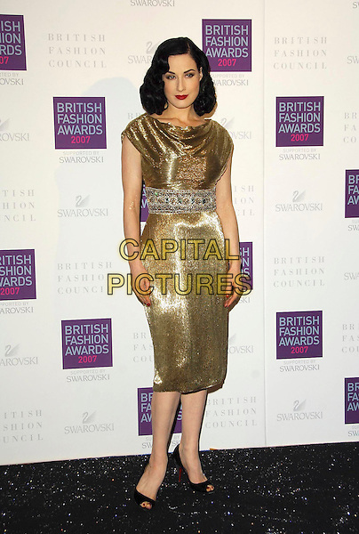 DITA VON TEESE.Arriving at the British Fashion Awards 2007 at the Horticulutral Hall London, Engalnd, .27th November  2007..full length red shiny gold dress.CAP/CAS.©Bob Cass/Capital Pictures.