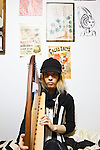 """In this photo made available on May 31, 2012 shows Mao Sugiyama in his room holding a harp on his bed in Kanagawa, near Tokyo, Japan, on May, 29, 2012. Mao Sugiyama, 22, self-described as an asexual now just 2 months old, is a cartoonist, painter and illustrator living in Japan. Mao hated the idea of love and sex due to a series of past events relating to close people around him becoming victims of sexual crimes. In an effort to free himself from mankind, Mao underwent a surgical procedure in Tokyo to remove his male genitals and later serve them to paying guests at a small dinner event. He spent two years conducting extensive research about the removal of his genitals and had several sexual experiences with others prior to the surgery. The reasoning behind Mao's idea to host an event where he would cook his male parts and serve them to guests, was he needed to earn money to help cover the ongoing medical costs of the procedure. Five individuals consisting of men and women out of a small crowd who attended the dinner, ate Mao's specially cooked genitals. The men, however, were not able to completely finish eating the genitals as they grew disgusted whereas the women were able to finish everything on their plates entirely. The women commented on Mao's parts as """"delicious."""" With Mao being an artist that he is, his vision is to create beautiful art without the realization of being a man or woman and excluding love and sex out of his system completely. (Photo by Christopher Jue/Nippon News)"""