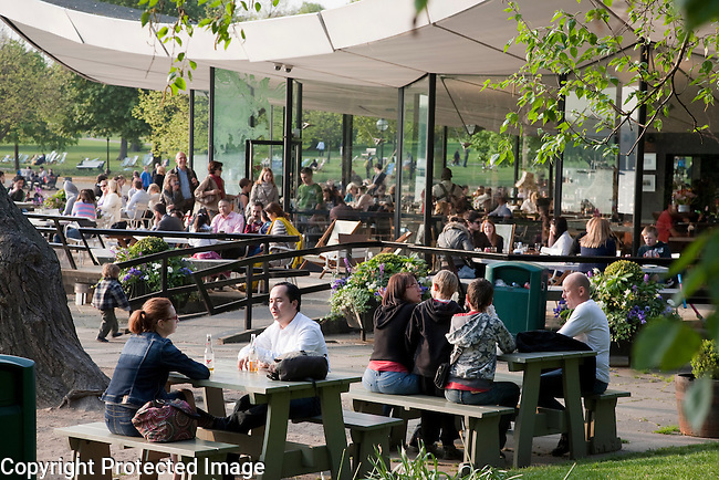 People Eating and Drinking in the Cafe by the Serpentine in Hyde Park, London, England, UK