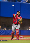 1 April 2016: Boston Red Sox catcher Sandy Leon gets Toronto Blue Jays catcher Josh Thole out at first for the second out of the 8th inning on a strikeout play at Olympic Stadium in Montreal, Quebec, Canada. The Red Sox defeated the Blue Jays 4-2 in the first of two MLB weekend exhibition games, which saw an attendance of 52,682 at the former home on the Montreal Expos. Mandatory Credit: Ed Wolfstein Photo *** RAW (NEF) Image File Available ***