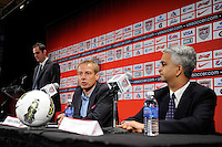 New US Men's National Team Head Coach Jurgen Klinsmann address the media as United States Soccer Federation President Sunil Gulati listens during a press conference at NIKETOWN in New York, NY, on August 01, 2011.