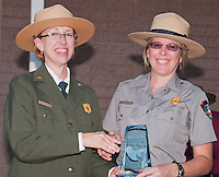 Park Superintendent Sarah Craighead presents an award to Ranger Carole Wendler at the Grand Re-Opening of the Furnace Creek Visitor Center in Death Valley National Park, California, on November 4, 2012.