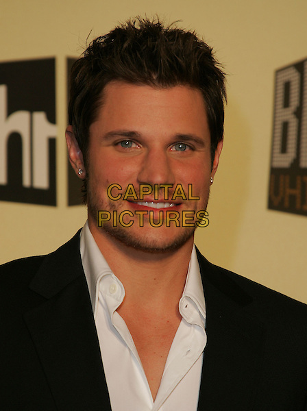 NICK LACHEY.The VH1 Big in 04  Award Show held at The Shrine Auditorium in Los Angeles, California .December 1, 2004.headshot, portrait, stubble, facial hair, earring, piercing.www.capitalpictures.com.sales@capitalpictures.com.Supplied by Capital Pictures