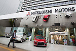 April 26, 2012, Tokyo, Japan - A businessman walks past the Mitsubishi Motors Corp headquarters. Japan's Mitsubishi Motors posted a 53% net profit increase for fiscal year to March which is partly due to the company's cost cutting plan. As Japan's fourth-largest automaker, the company earned 23.9 billion Japanese yen ($294 million) in the past year, which is up from 15.6 billion Japanese yen in the previous period. (Photo by Christopher Jue/AFLO)