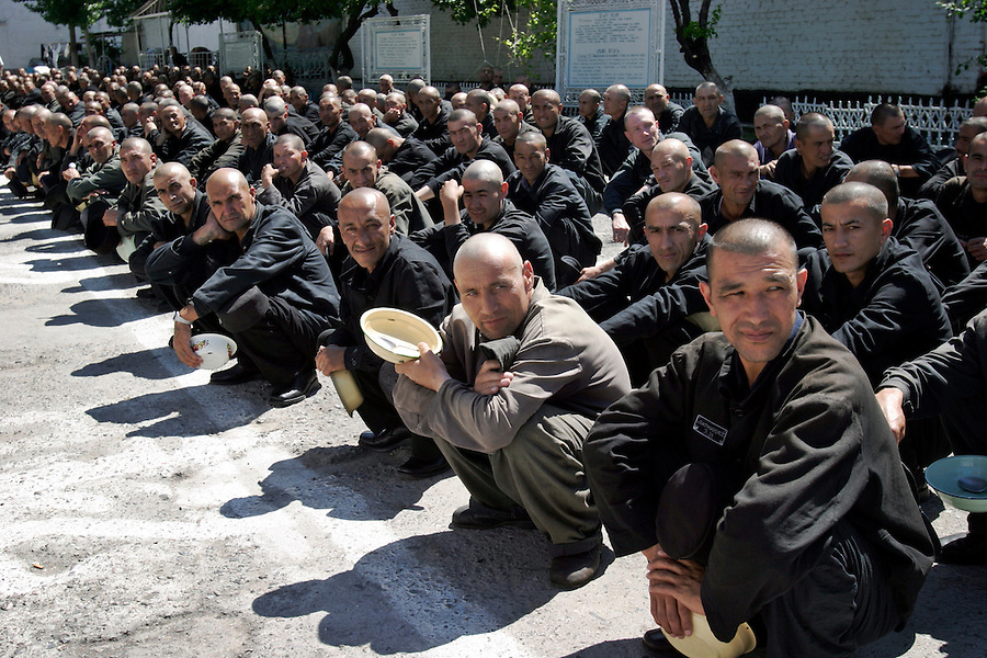 Tashkent, Uzbekistan, 11/05/2004..Penal Colony Number One, Uzbekistan's largest prison, houses both ordinary criminals and those convicted of terrorist offences. Prisoners squat in the prison courtyard while waiting to be marched to the canteen.