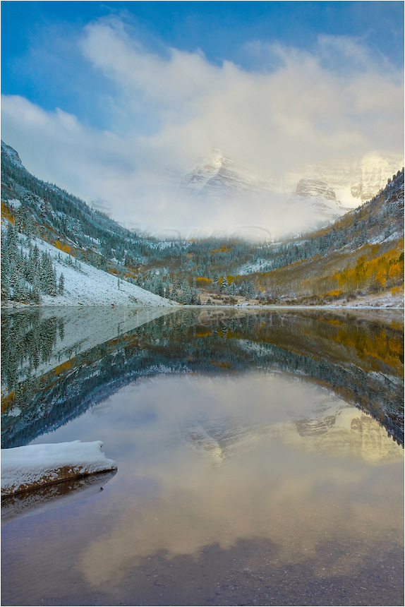 On a cold autumn morning, the Maroon Bells awakens to a snowy morning. Each fall, a lot of landscape photographers flock to this icon of Colorado - one of the most photographed places in the state.
