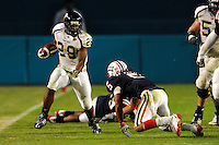 29 November 2008:  FIU running back Darriet Perry (28) cuts through the FAU secondary in the FAU 57-50 overtime victory over FIU in the annual Shula Bowl at Dolphin Stadium in Miami, Florida.