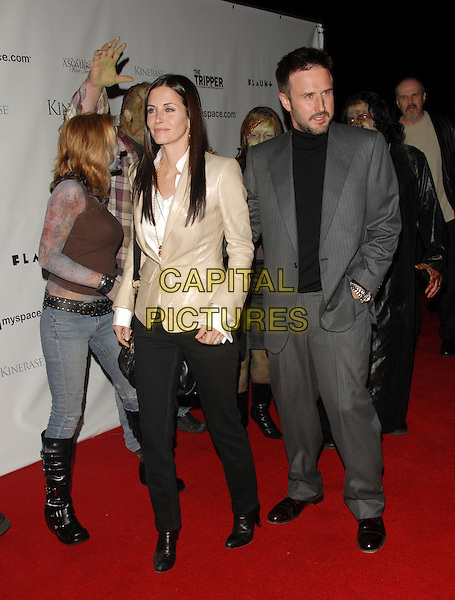 DAVID ARQUETTE  & COURTENEY COX ARQUETTE .Attends The Tripper Premiere held at The Hollywood Forever Cemetary in Hollywood, California, USA..April 11th, 2007.full length grey gray suit jacket Courtney married husband wife beard stubble facial hair beige leather jacket suit black trousers zombies.CAP/DVS.©Debbie VanStory/Capital Pictures