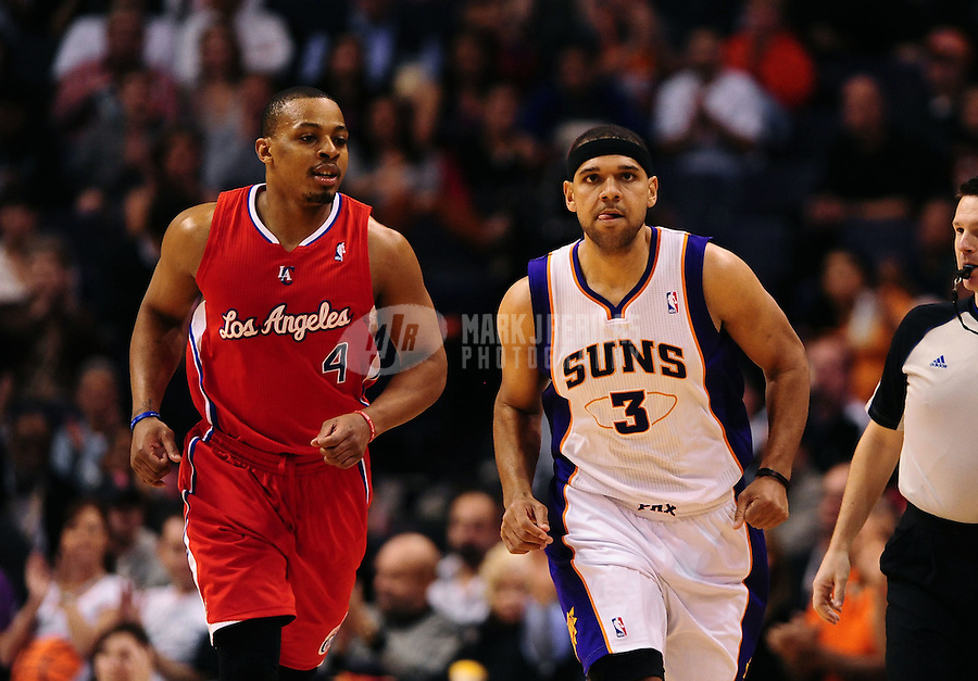 Mar. 2, 2012; Phoenix, AZ, USA; Los Angeles Clippers guard Randy Foye (left) and Phoenix Suns forward Jared Dudley at the US Airways Center. The Suns defeated the Clippers 81-78. Mandatory Credit: Mark J. Rebilas-USA TODAY Sports