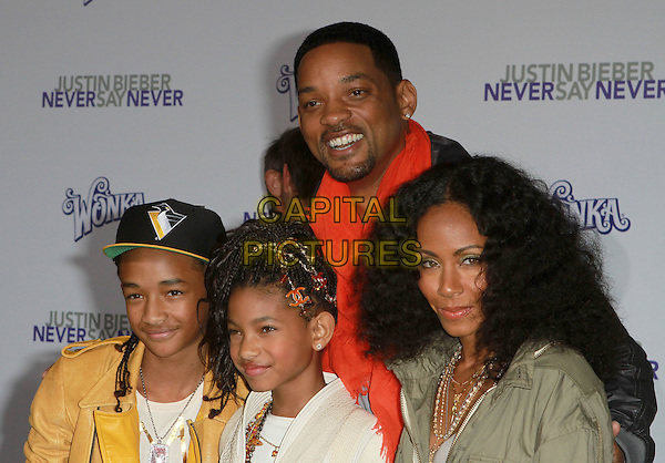 "JADEN SMITH, WILLOW SMITH, WILL SMITH & JADA PINKETT SMITH.Attending ""Justin Bieber: Never Say Never"" Los Angeles Premiere held At Nokia Theatre L.A Live, Los Angeles, California, USA, .8th February 2011..half length sister brother siblings family yellow leather jacket cap hat cream white jeans trousers mother father dad mum parents green khaki coat parker parker chanel hair clip orange .CAP/ADM/KB.©Kevan Brooks/AdMedia/Capital Pictures."